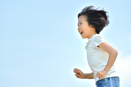 Girls running in the blue sky Stock Photo