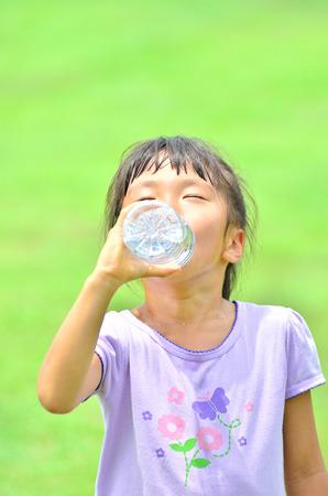 Girls drinking water Stock Photo