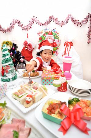 Girls enjoy Christmas party Stock Photo