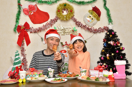 Parent and child enjoy Christmas party