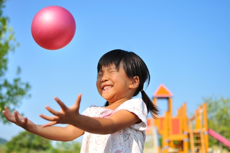 Girl's playing with ball