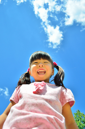 Girls smiling in the blue sky