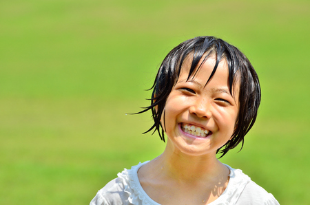 Girl's smiling in the grassland Stock Photo