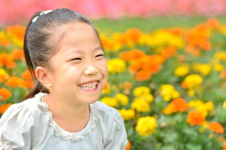 Girls smiling in the flower garden