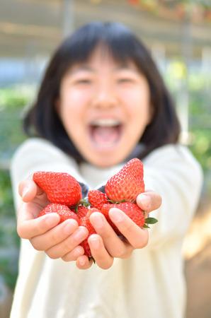 Girl's enjoying strawberry picking