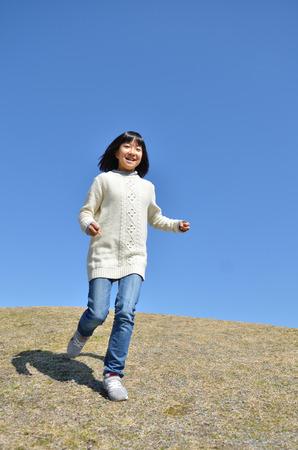 Girl's running in the blue sky