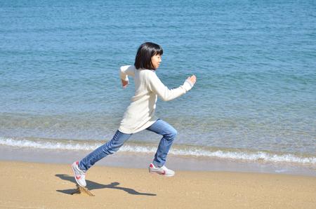 Girls running in the beach