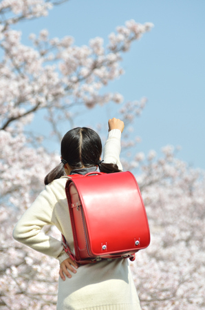 Japanese elementary school student just graduated and happy Stock Photo