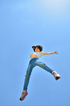 Girl's jumping in the blue sky