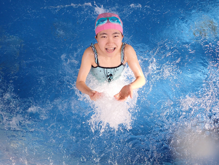 Japanese girl playing in the swimming pool