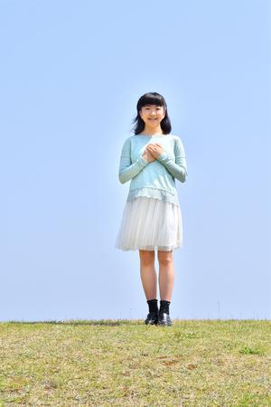 Japanese girl smiling in the blue sky Zdjęcie Seryjne