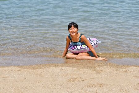 Japanese girl enjoys sea bathing - summer vacation
