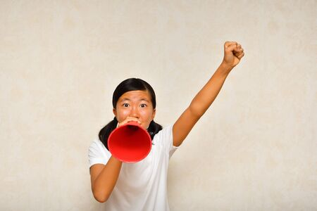 Japanese girl is cheering with megaphone Banco de Imagens