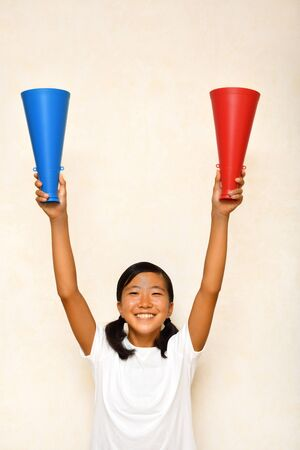 Japanese girl is cheering with megaphone Stock Photo