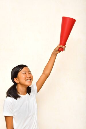 Japanese girl is cheering with megaphone