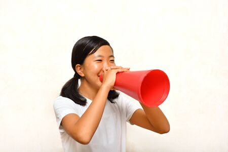 Japanese girl cheering with megaphone 写真素材
