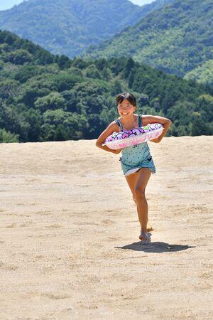 Japanese girl running in the beach