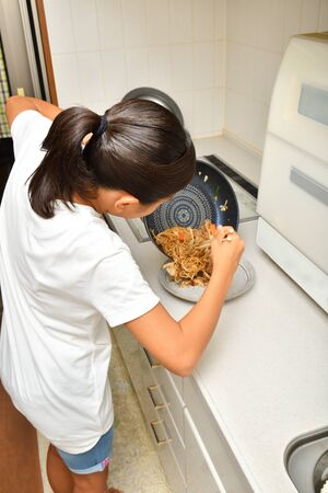 Japanese girl enjoys cooking in the kitchen