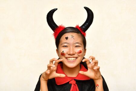 Japanese girl enjoys Halloween party Stockfoto