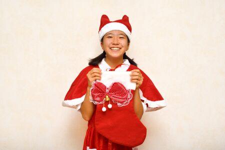 Japanese girl enjoys Christmas party Stock Photo