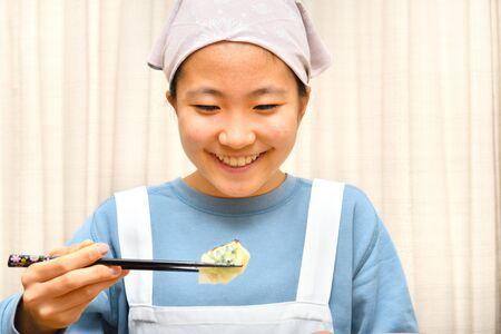 Japanese girl enjoys having Chinese dumplings