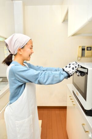 Japanese girl cooking in the kitchen