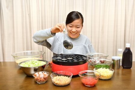 Japanese girl enjoys Octopus fritters party Zdjęcie Seryjne