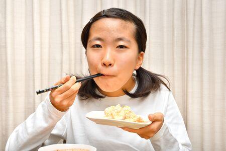 Japanese girl enjoys having dinner