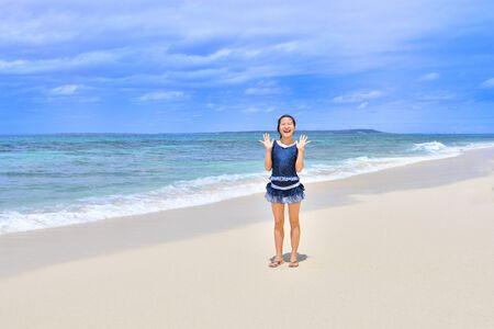 Japanese girl smiling in the beach - Okinawa Miyakojima rear view