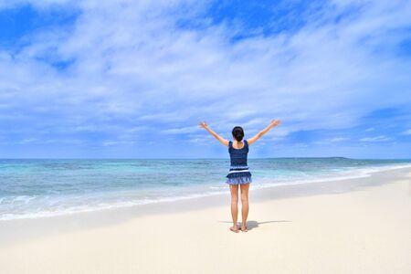 Japanese girl standing in the beach - Rear view Okinawa Miyakojima