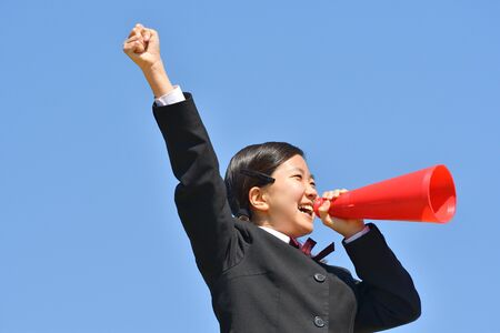 Japanese girl cheering in the blue sky