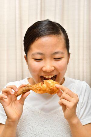 Japanese girl enjoys having fried chicken