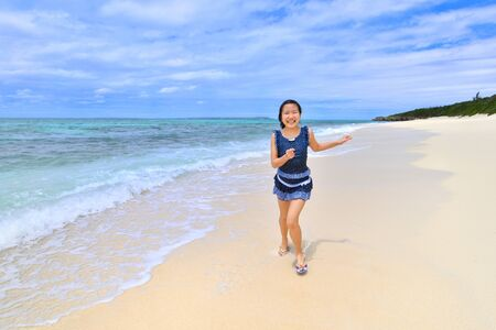 Japanese girl running in the beach - Okinawa Miyakojima