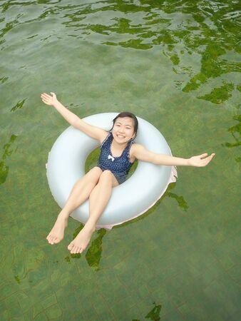 Japanese girl enjoy having the open air bath