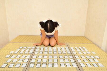 Japanese girl playing Japanese card game on Tatami mats