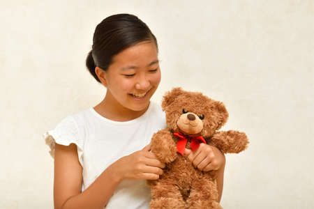 Japanese girl playing with stuffed toy