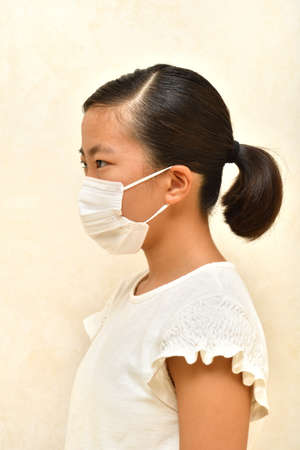 Japanese girl wearing mask not to suffer illnesses