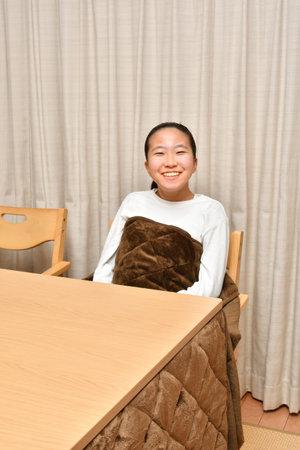 Japanese girl having a warm by Kotatsu 스톡 콘텐츠