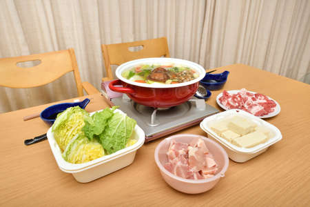 Japanese dish cooked in a hot pot at the table - Nabe party