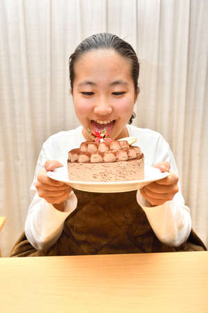 Japanese girl with the whole of cake