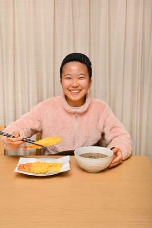 Japanese girl eating Japanese traditional noodle