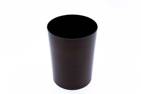 Brown trash can on white background