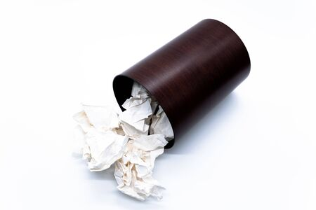 Waste paper and trash on white background