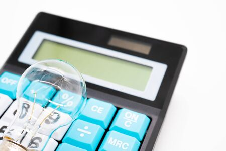 Calculator and light bulb Standard-Bild - 147556119
