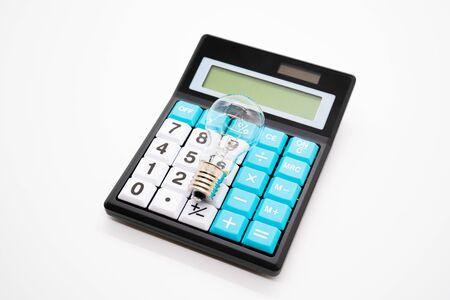 Calculator and light bulb Standard-Bild - 147556792