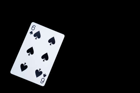 Playing card on a black background, spade 6 版權商用圖片