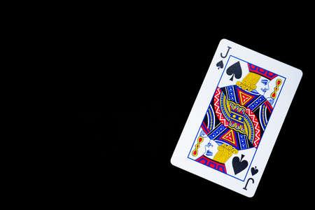 Playing card, spade jack on black background