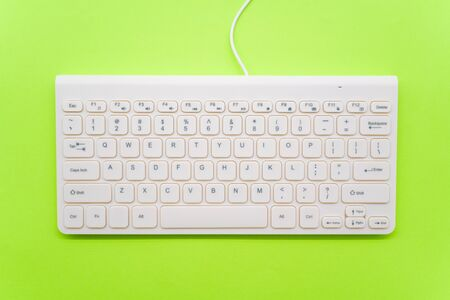 Keyboard on green background Imagens