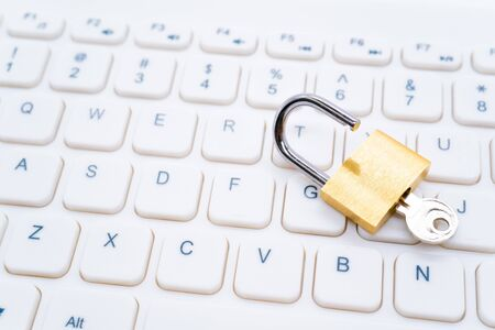 Golden Padlock on Keyboard Cyber Security Concept