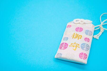 Japanese protection talisman on blue background